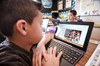 Yokomi student on a computer